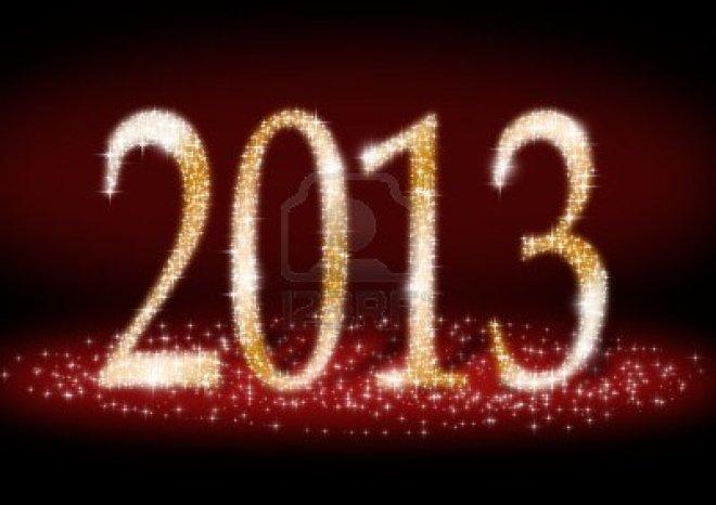 15719072-data-di-capodanno-2013-di-luce-scintilla-su-sfondo-rosso-scuro